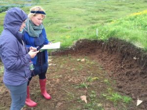 Rannveig shows Erin a recent dig, believed to be the wall of a house.